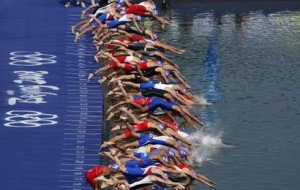 Competitors start the swim portion of the men's triathlon competition at the Ming Tomb reservoir in the Changping District of northern Beijing during the Beijing 2008 Olympic Games